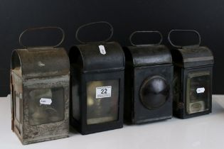 A collection of four vintage railway lamps to include a GWR example.