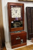 A vintage National Time Recorder Co. punch card machine, dial marked St. Mary Cray, Kent.