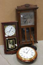 A vintage oak cased wall clock.