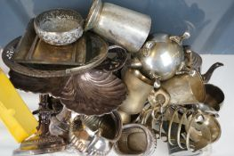 A collection of silver plated items to include candlesticks, teapots, sugar bowl, jugs and spoons.