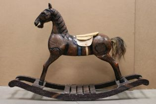 Wooden Rocking Horse raised on a bow rocker, 124cms long x 85cms high