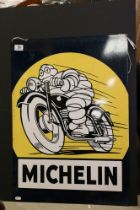 A reproduction Michelin motorcycle tyre's enamel sign.