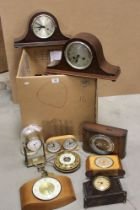 A collection of vintage clocks and barometers to include anniversary and mantle examples.