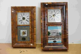 Two vintage wooden cased American wall clocks with decorative glass panels.