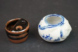 A Chinese ink well together with a Chinese brush pot.