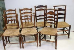 Three Pairs of Oak Ladder Back Chairs with Rush Seats together with one other similar chair