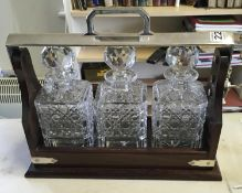 Superb mahogany antique style 3 item Tantalus with key and in working order, 3 x cut glass Whisky