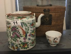 19 th century Famille Rose tea pot and lid, in rattan carrying case, with a single 19 th century