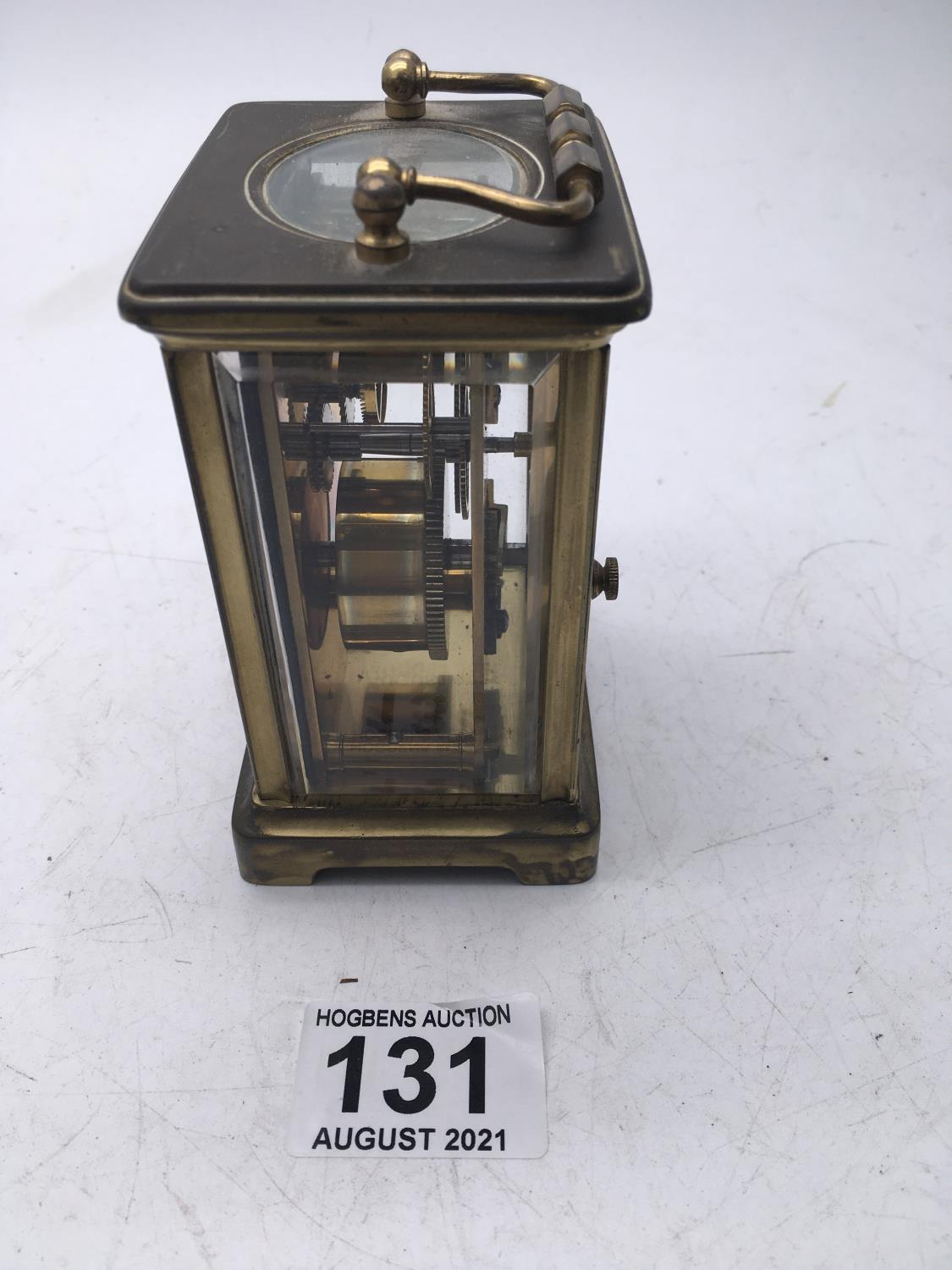 Maple & Co a brass bound carriage clock with enamel dial, movement runs for 1 minute approx - Image 2 of 3