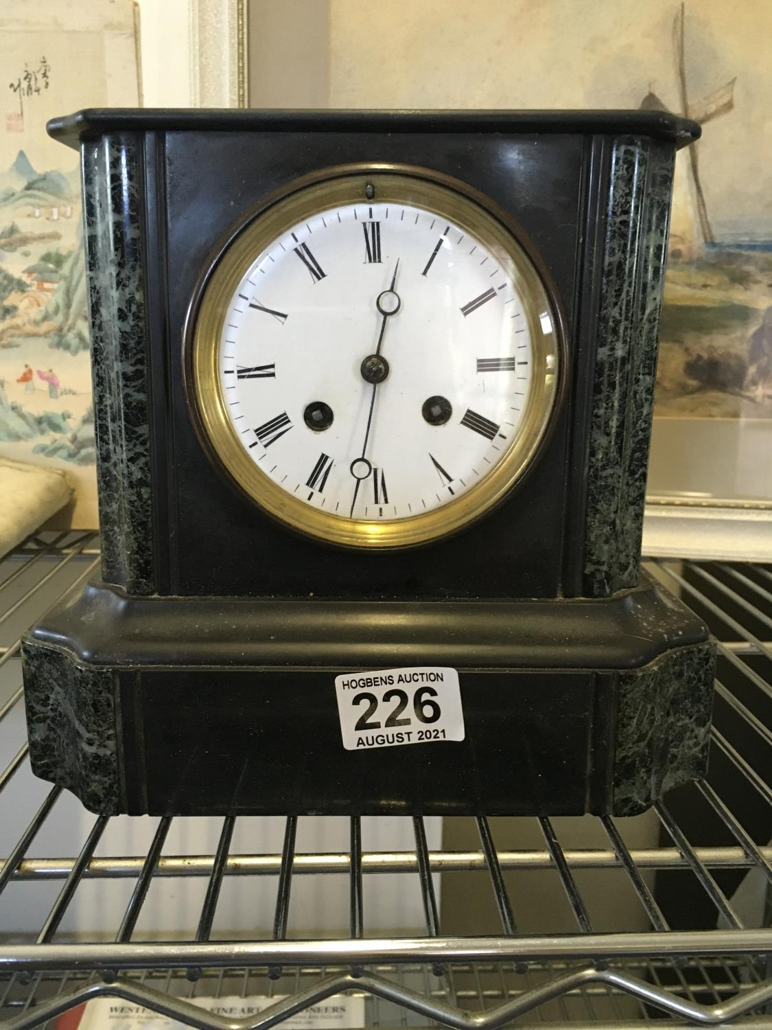 19c slate and marble mantle clock with an 8 day time piece striking on a bell, makers mark to