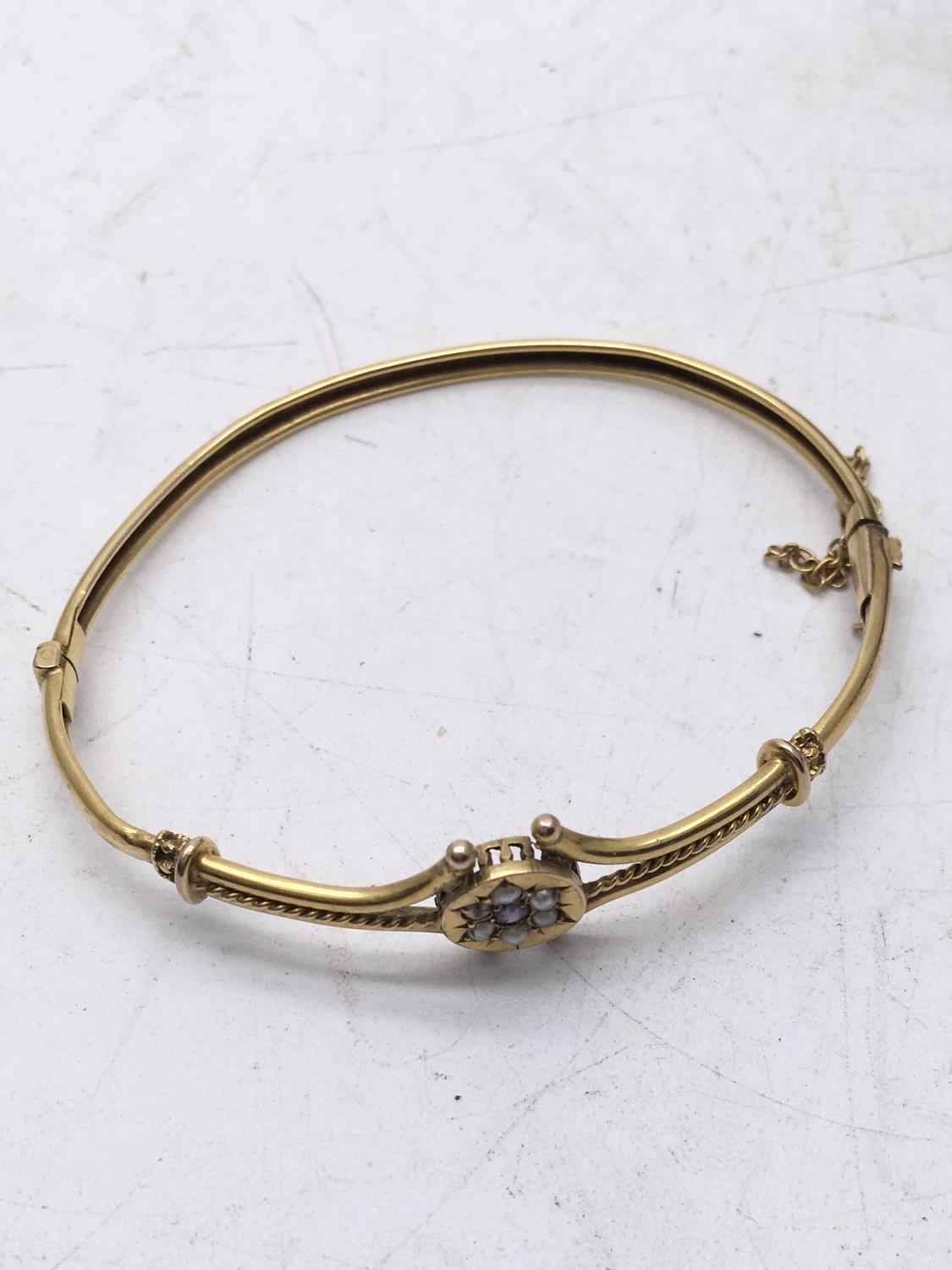 Delicate Victorian period Ladies bangle with gold coloured body set with seed pearl and amethyst - Image 3 of 4