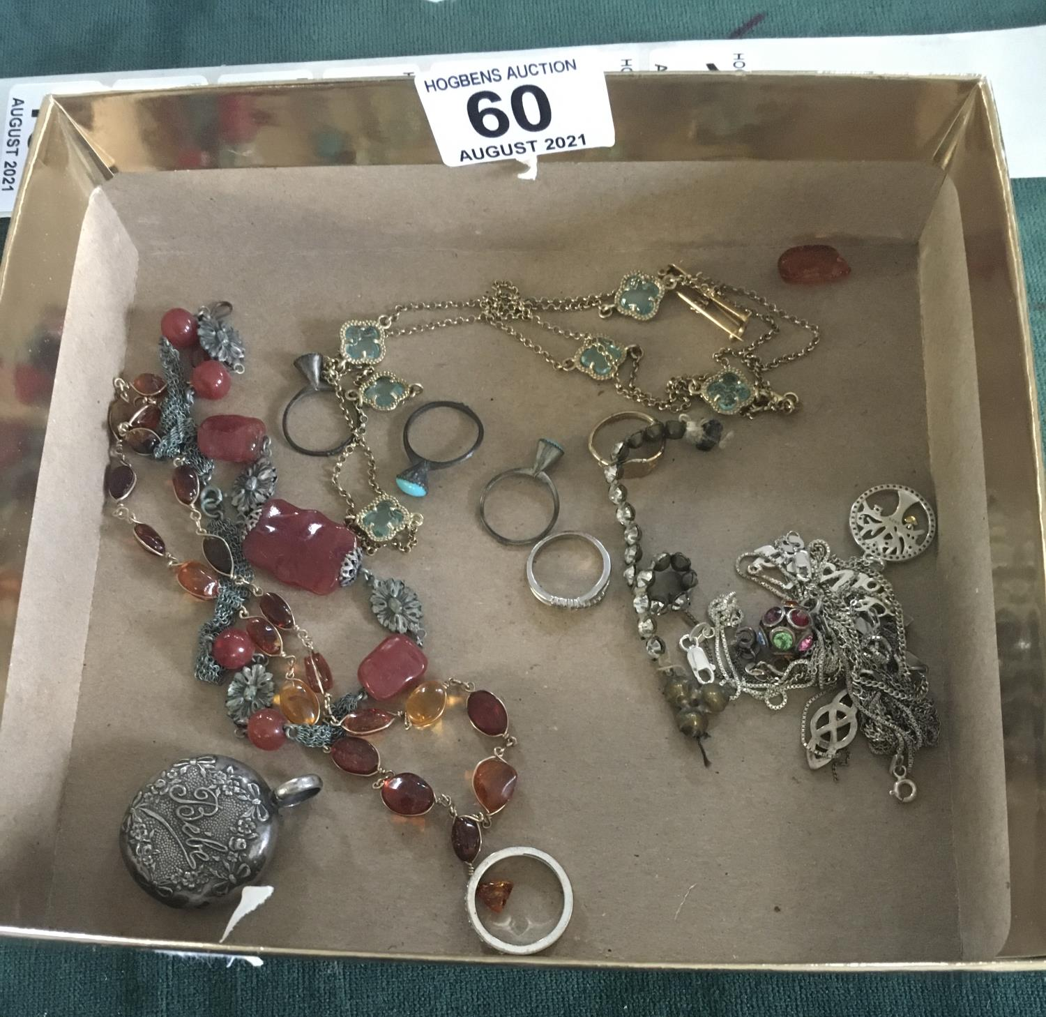 Amber beads, and other jewellery items including some tangled silver necklaces,