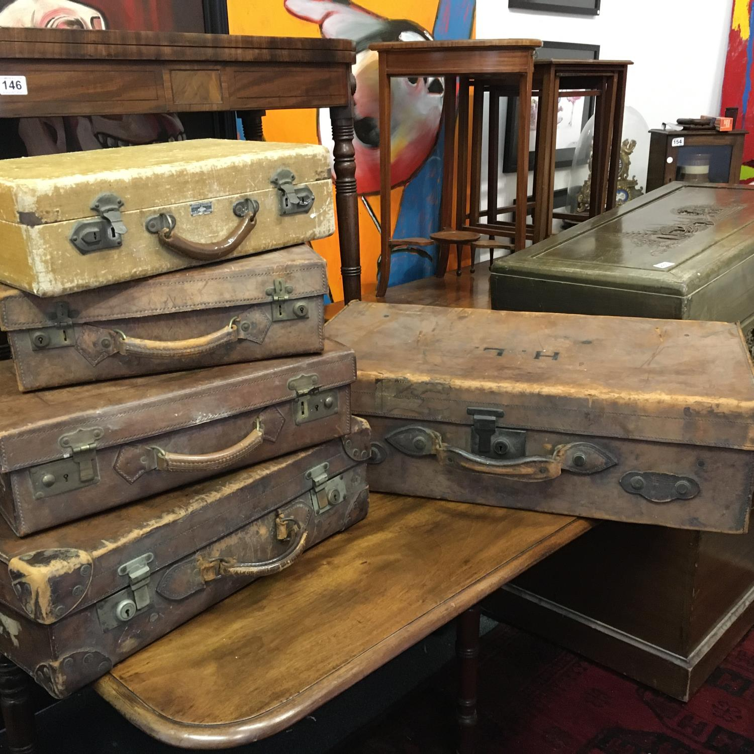 4 x matching antique leather suitcases of graduating size in what appears to be a set of 4, and 1