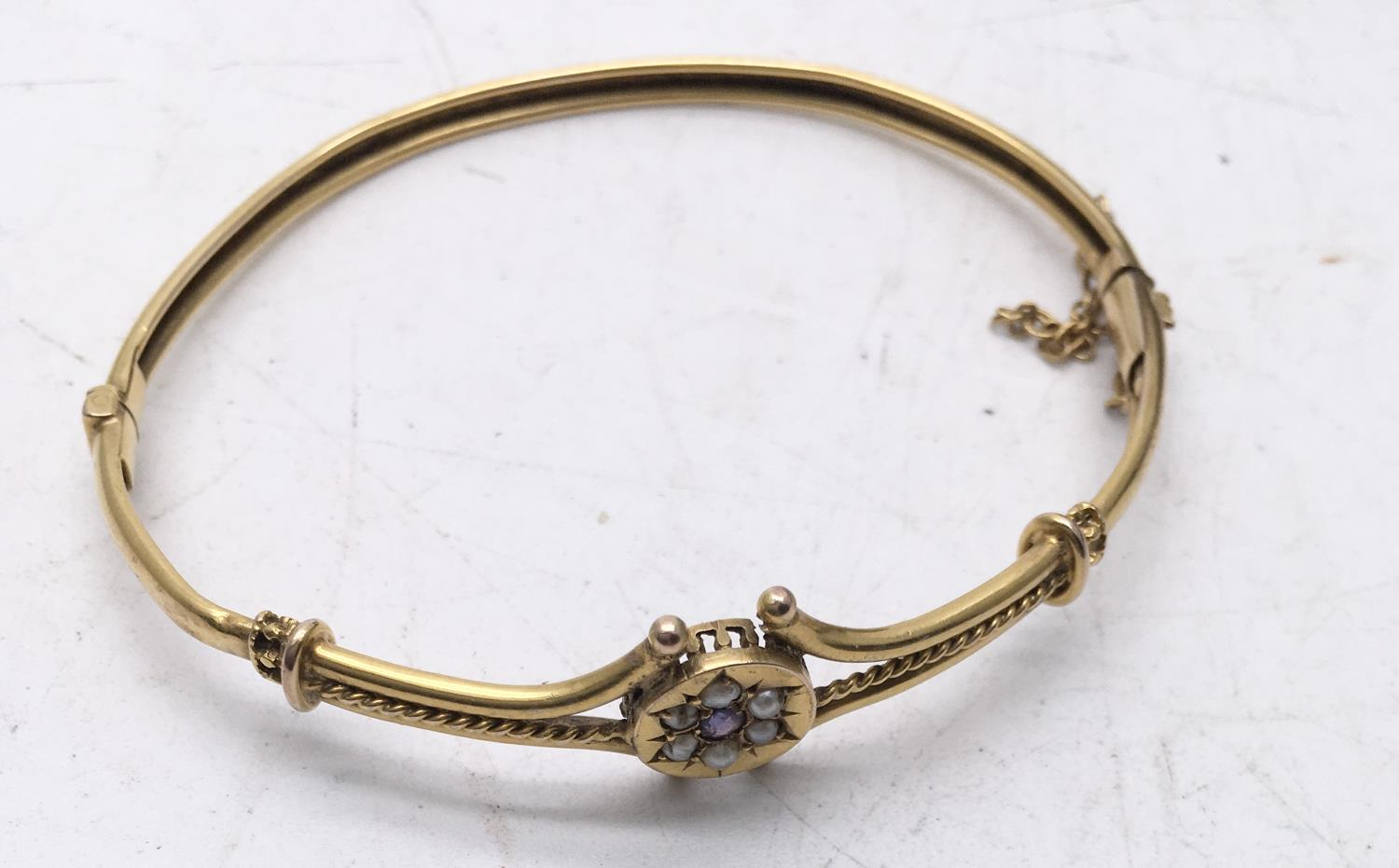 Delicate Victorian period Ladies bangle with gold coloured body set with seed pearl and amethyst - Image 4 of 4