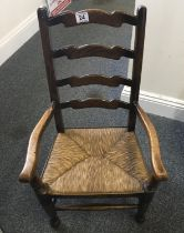 Children's 19 th century ladder backed chair with rush seating area