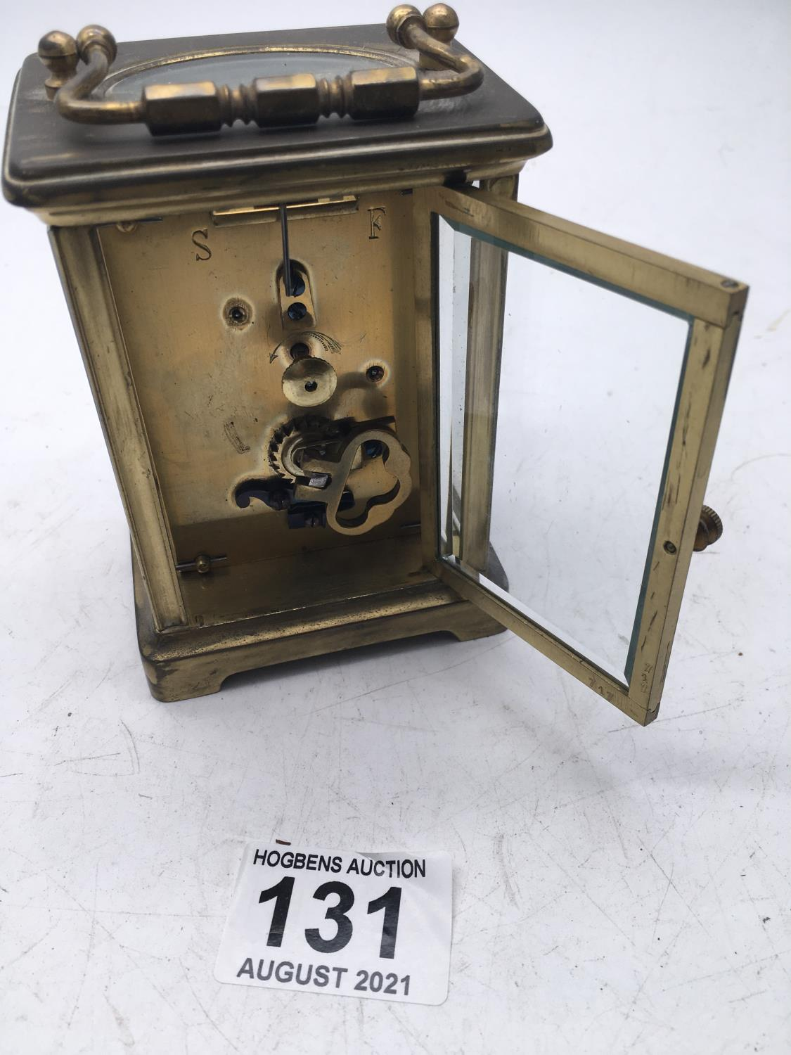 Maple & Co a brass bound carriage clock with enamel dial, movement runs for 1 minute approx - Image 3 of 3