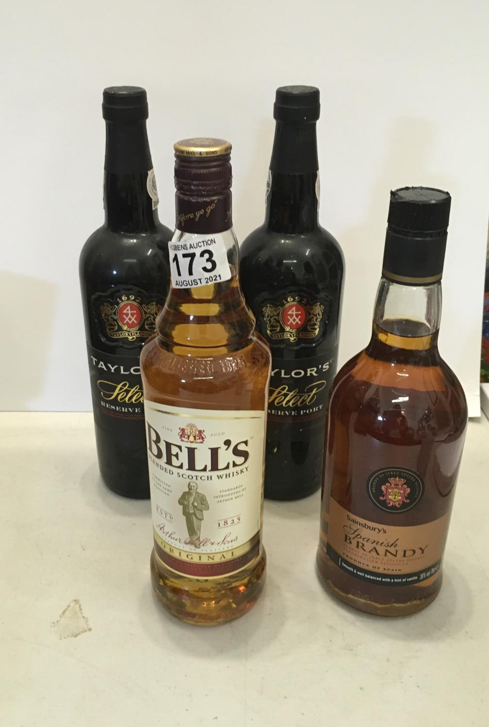 Single bottle of Bells Whisky 75cl un-opened, single bottle of Spanish Brandy 70cl un-opened, and