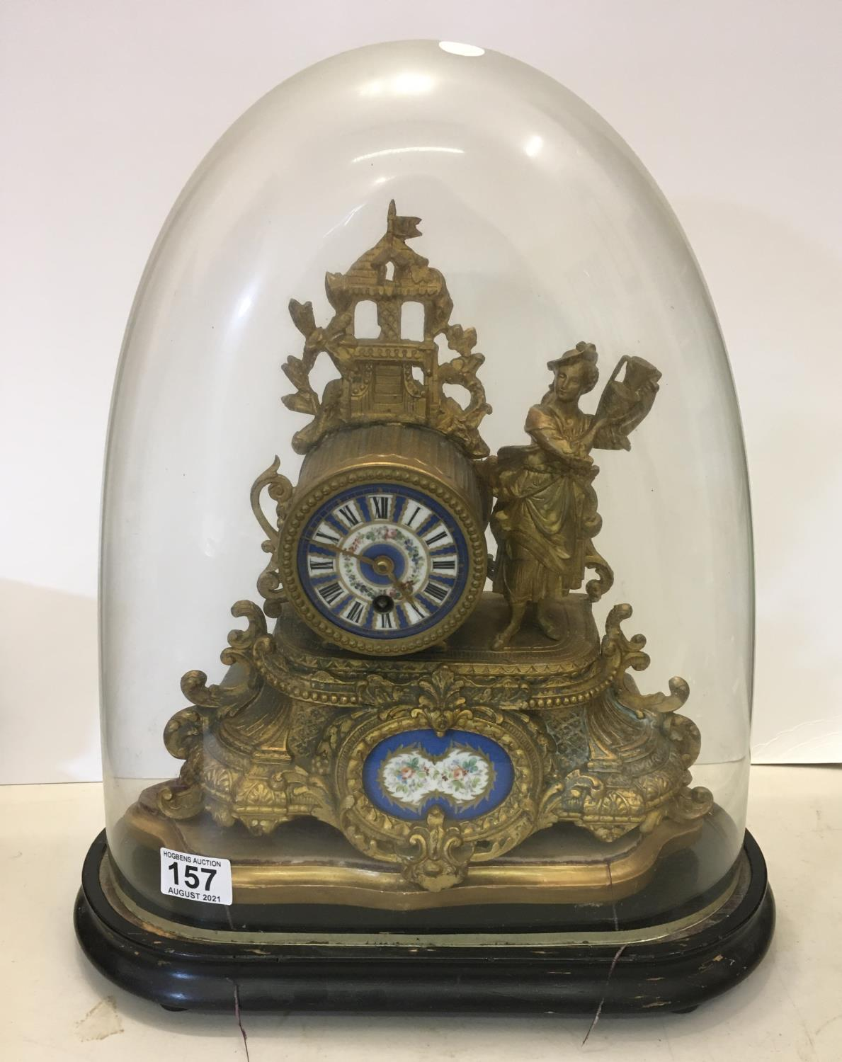 Gilt spelter mantle clock with figural Lady to the side, probably with Sevres plaques on original