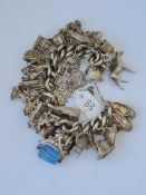 Good heavy silver charm bracelet set with oodles of charms 156g