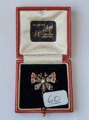 An attractive gemset butterfly brooch