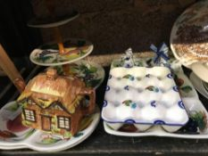 SHELF OF CHINAWARE INCL; PLATES, CAKE STANDS & ORNAMENTS
