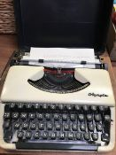 OLYMPIA CASED PORTABLE TYPEWRITER WITH METAL COVER