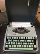CASED HERMES BABY TYPEWRITER IN GOOD CONDITION IN GREEN CASE