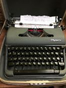 CASED OLYMPIA TYPEWRITER - GOOD CONDITION