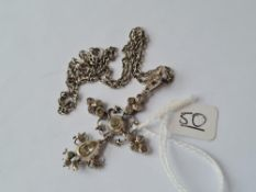An antique silver paste set pendant on a silver chain