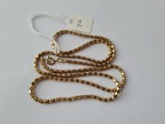 A fancy link neck chain in 9ct - 11gms
