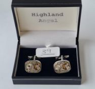A cased pair of watch movements cufflinks