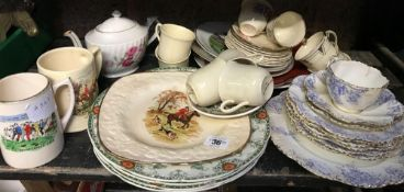 SHELF OF CHINAWARE INCL; JUGS, PLATES, CUP & SAUCERS, SOME HUNTING SCENES ETC