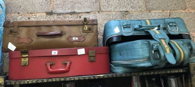 4 SUITCASES OF VARYING AGES