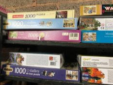 2 SHELVES OF JIGSAW PUZZLES