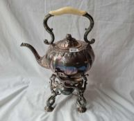 A Victorian spirit kettle on stand with shell feet (one side support inside) 16 inches high