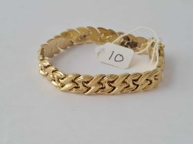 A GOLD ARTICULATED BRACERLET IN 14CT GOLD - 19.2 GMS