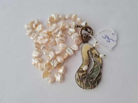 A silver and mother of pearl pendant necklace