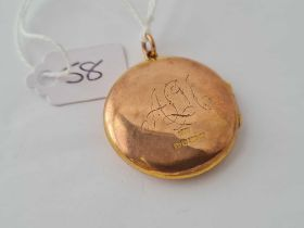 A circular locket 9ct -7.4 gms
