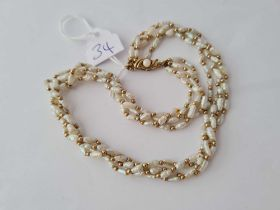 A four row pearl necklace 9ct clasp