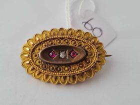 A diamond and ruby photo locket brooch - 8.1 gms