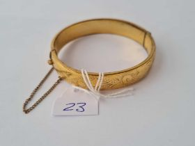 A rolled gold bangle