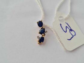 A small sapphire and diamond pendant 9ct