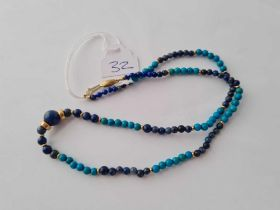 A silver and lapis bead necklace with 9ct clasp