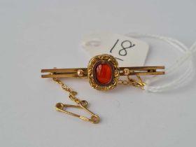 A small 9ct bar brooch set with an earlier Georgian gold mounted Cornelian