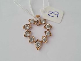 A white stone set pendant in gold - 4.5 gms