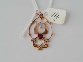 An antique 9ct pendant set with with pearls and a centre garnet