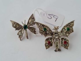 A silver and paste butterfly brooch together with a smaller example