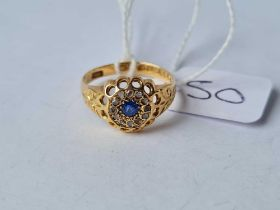 A sapphire and diamond cluster ring ( B'ham 1915 ) in 18 ct gold size O - 2.8 gms
