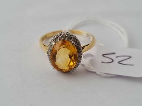 A citrine and diamond cluster ring in 18ct gold size P1/2 - 3.9gms