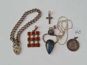 A silver bracelet and pendants 45g inc